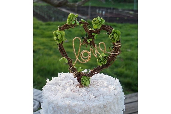 love cake topper with greenery