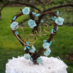 love vine flower cake topper with blue flowers