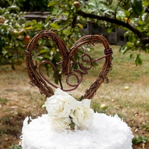 rustic vine topper with flower