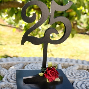 black table number with rose
